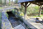 TEXT_PHOTO 1 - A vendre secteur VILLEDIEU LES POELES (50800) ancien moulin avec roue et bief sur 3,4 ha de terrain