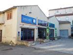 Immeuble composé de 3 locaux commerciaux avec parking et d'un atelier de